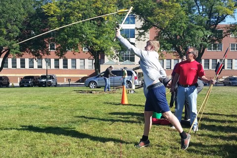 Student throwing an atlatl